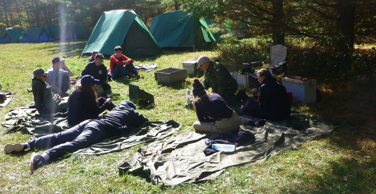 Capt Buckley instructing senior cadets on how to use lanterns and stoves on the fall 2016 FTX (Photo by Maj D. Irish)