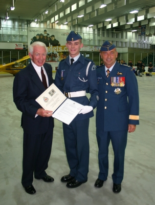 MGen (Ret.) J.D. O'Blenis and LGen J.A.J.Y. Blondin presenting the O'Blenis Trophy and Cadet Scholarship to WO2 Riley at the 2014 ACR (Photo by S. Mayne)