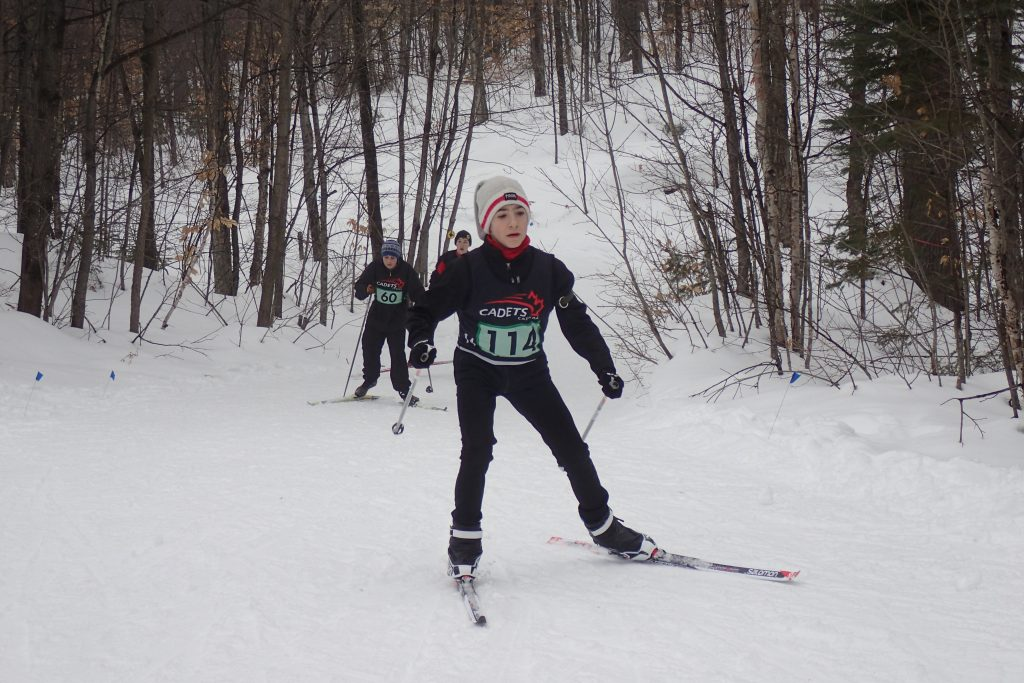 Marsh passes on hill during biathlon